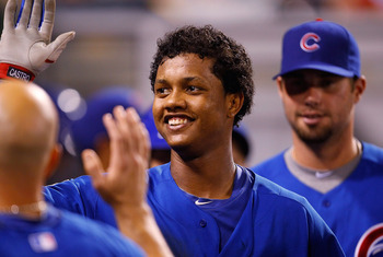 PITTSBURGH - AUGUST 03:  Starlin Castro #13 of the Chicago Cubs is congratulated by teammates in the dugout after hitting a solo home run against the Pittsburgh Pirates during the game on August 3, 2011 at PNC Park in Pittsburgh, Pennsylvania.  (Photo by