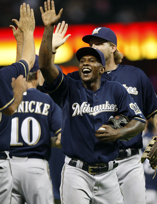 HOUSTON - AUGUST 05:  Nyjer Morgan #2 of the Milwaukee Brewers celebrates their win over the Houston Astros 8-1 at Minute Maid Park on August 5, 2011 in Houston, Texas.  (Photo by Bob Levey/Getty Images)