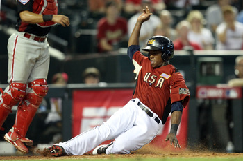 PHOENIX, AZ - JULY 10:  U.S. Futures All-Star Tim Beckham #22 of the Tampa Bay Rays slides safely to score a run in the eighth inning during the 2011 XM All-Star Futures Game at Chase Field on July 10, 2011 in Phoenix, Arizona.  (Photo by Christian Peters