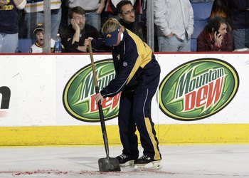 BUFFALO, NY - FEBRUARY 10: An arena worker scrapes the blood of Richard Zednik #20 of the Florida Panthers off of the ice after Zednik was severly cut during play against the Buffalo Sabres on February 10, 2008 at HSBC Arena in Buffalo, New York. Zednik w