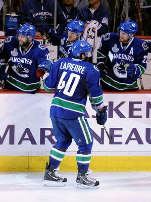 VANCOUVER, BC - JUNE 10:  Maxim Lapierre #40 of the Vancouver Canucks celebrates with his team after scoring a goal in the third period against the Boston Bruins during Game Five of the 2011 NHL Stanley Cup Final at Rogers Arena on June 10, 2011 in Vancou