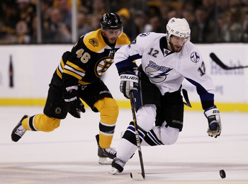 BOSTON, MA - MAY 23:  Simon Gagne #12 of the Tampa Bay Lightning controls the puck against David Krejci #46 of the Boston Bruins in Game Five of the Eastern Conference Finals during the 2011 NHL Stanley Cup Playoffs at TD Garden on May 23, 2011 in Boston,