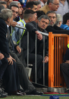 MADRID, SPAIN - APRIL 27:  Jose Mourinho the coach of Real Madrid watches from the stand after being sent off during the UEFA Champions League Semi Final first leg match between Real Madrid and Barcelona at Estadio Santiago Bernabeu on April 27, 2011 in M