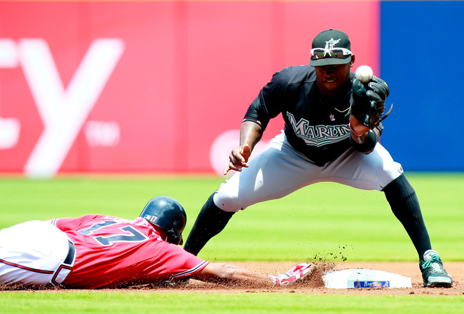 ATLANTA, GA - JULY 31:  Jose Constanza #17 of the Atlanta Braves slides safely back into second base as Hanley Ramirez #2 of the Florida Marlins bobbles the catch in the first inning at Turner Field on July 31, 2011 in Atlanta, Georgia.  (Photo by Kevin C