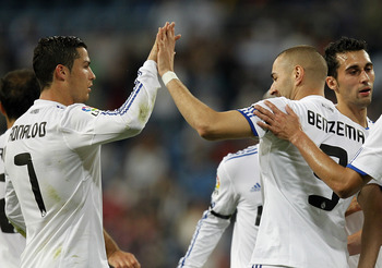 MADRID, SPAIN - MAY 10:  Karim Benzema (R) of Real Madrid celebrates with Cristiano Ronaldo after scoring his side third goal during the La Liga match between Real Madrid and Getafe at Estadio Santiago Bernabeu on May 10, 2011 in Madrid, Spain.  (Photo by