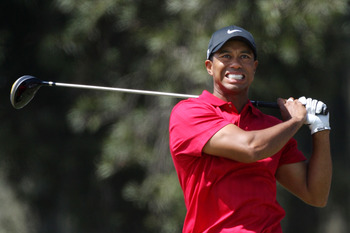 SAN DIEGO - JUNE 15:  Tiger Woods reacts to his tee shot and knee injury during the final round of the 108th U.S. Open at the Torrey Pines Golf Course (South Course) on June 15, 2008 in San Diego, California.  (Photo by Ross Kinnaird/Getty Images)