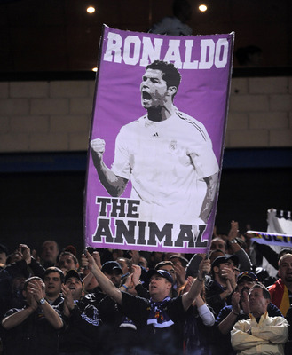 MADRID, SPAIN - MARCH 19:  A Real Madrid fan holds up a banner of Cristiano Ronaldo before the start of the La Liga match between Atletico Madrid and Real Madrid at Vicente Calderon Stadium on March 19, 2011 in Madrid, Spain.  (Photo by Denis Doyle/Getty