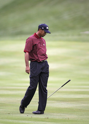 UNITED STATES - SEPTEMBER 24:  Tiger Woods of the U.S. team drops his club after a shot during the four-ball matches in the third round of The Presidents Cup at Robert Trent Jones Golf Club in Prince William County, Virginia on September 24, 2005.  (Photo