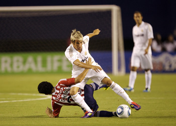 SAN DIEGO, CA - July 20:  Fabio Coentrao #15 of Real Madrid is challenged for possession of the ball by Edgar Mejia #20 of CD Guadalajara during the first half of their game at Qualcomm Stadium on July 20, 2011 in San Diego, California. (Photo by Kent Hor