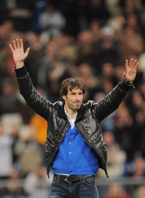 MADRID, SPAIN - JANUARY 24: Ruud Van Nistelrooy of Real Madrid waves to the public at the Santiago Bernabeu stadium before the start of the La Liga match between Real Madrid and Malaga on Sunday January 24, 2010 in Madrid Spain. Van Nistelrooy has joined