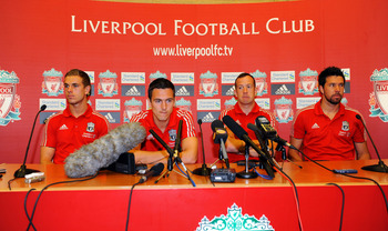 LIVERPOOL, UNITED KINGDOM - AUGUST 03:  Liverpool FC present new signings Charlie Adam (2ndR), Alexander Doni (R), Stewart Downing (2ndL) and Jordan Henderson (L) at a press conference at Melwood Training Ground on August 03, 2011 in Liverpool , England.