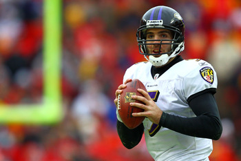 KANSAS CITY, MO - JANUARY 09:  Quarterback Joe Flacco #5 of the Baltimore Ravens looks to pass against the Kansas City Chiefs in their 2011 AFC wild card playoff game at Arrowhead Stadium on January 9, 2011 in Kansas City, Missouri.  (Photo by Dilip Vishw