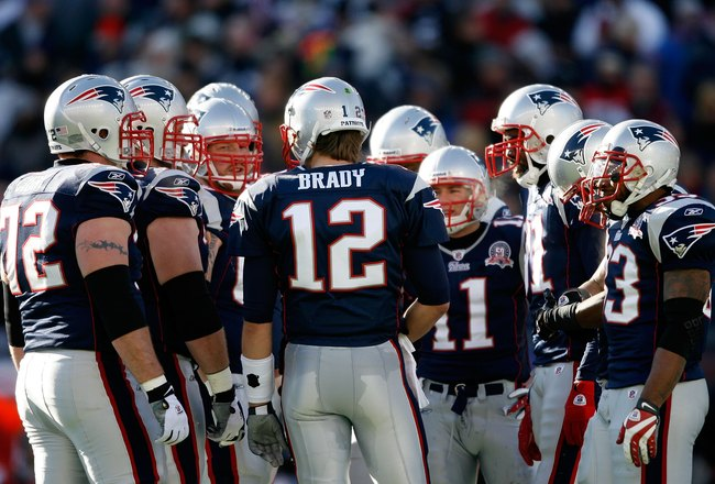 FOXBORO, MA - JANUARY 10:  Tom Brady #12 of the New England Patriots calls a play in the huddle against the Baltimore Ravens during the 2010 AFC wild-card playoff game at Gillette Stadium on January 10, 2010 in Foxboro, Massachusetts.  (Photo by Elsa/Gett