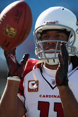 CHARLOTTE, NC - DECEMBER 19:  Larry Fitzgerald #11 of the Arizona Cardinals warms up before the start of their game against the Carolina Panthers at Bank of America Stadium on December 19, 2010 in Charlotte, North Carolina.  (Photo by Streeter Lecka/Getty