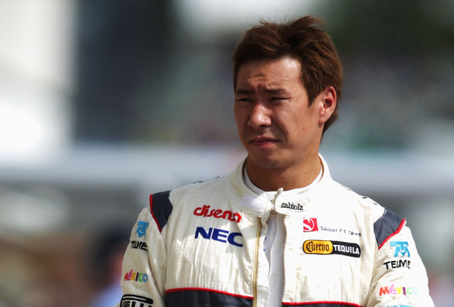 BUDAPEST, HUNGARY - JULY 29:  Kamui Kobayashi of Japan and Sauber F1 walks in the pitlane following practice for the Hungarian Formula One Grand Prix at the Hungaroring on July 29, 2011 in Budapest, Hungary.  (Photo by Vladimir Rys/Getty Images)