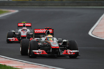 BUDAPEST, HUNGARY - JULY 31:  Lewis Hamilton of Great Britain and McLaren leads from team mate Jenson Button of Great Britain and McLaren during the Hungarian Formula One Grand Prix at the Hungaroring on July 31, 2011 in Budapest, Hungary.  (Photo by Vlad