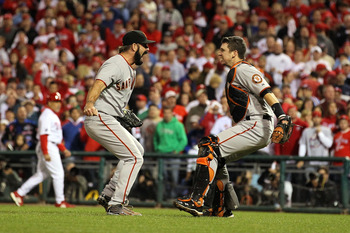 PHILADELPHIA - OCTOBER 23:  Buster Posey #28 and Brian Wilson #38 of the San Francisco Giants celebrate defeating the Philadelphia Phillies 3-2 and winning the pennant in Game Six of the NLCS during the 2010 MLB Playoffs at Citizens Bank Park on October 2