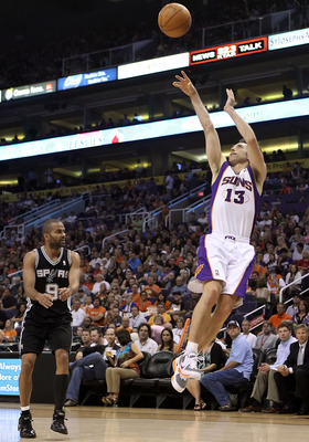 PHOENIX, AZ - APRIL 13:  Steve Nash #13 of the Phoenix Suns puts up a shot against the San Antonio Spurs during the NBA game at US Airways Center on April 13, 2011 in Phoenix, Arizona.  NOTE TO USER: User expressly acknowledges and agrees that, by downloa