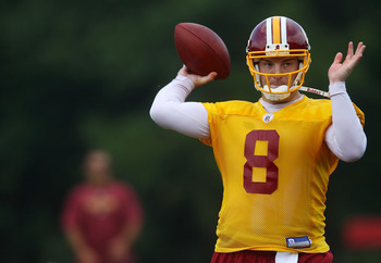 ASHBURN, VA - JULY 29:  Quarterback Rex Grossman #8 of the Washington Redskins throws a pass during drills on the first day of training camp July 29, 2010 in Ashburn, Virginia.  (Photo by Win McNamee/Getty Images)