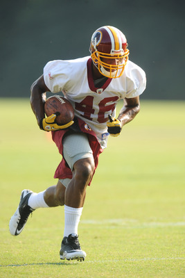 ASHBURN, VA - JULY 29:  Ryan Torain #46 of the Washington Redskins runs with the ball during the first day of training camp at Redskins Park on July 29, 2011 in Ashburn, Virginia.  (Photo by Mitchell Layton/Getty Images)