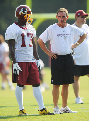 ASHBURN, VA - JULY 29:  Anthony Armstrong #13 and head coach Mike Shanahan of the Washington Redskins talk during the first day of training camp at Redskins Park on July 29, 2011 in Ashburn, Virginia.  (Photo by Mitchell Layton/Getty Images)