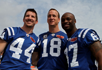 MIAMI GARDENS, FL - FEBRUARY 02:  Dallas Clark #44, Peyton Manning #18 and Reggie Wayne #87 of the Indianapolis Colts pose on the field during Super Bowl XLIV Media Day at Sun Life Stadium on February 2, 2010 in Miami Gardens, Florida.  (Photo by Doug Ben
