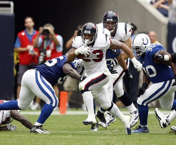 HOUSTON - SEPTEMBER 12:  Running back Arian Foster #23 of the Houston Texans rushes past defensive tackle Daniel Muir #90 of the Indianapolis Colts in  the first quarter  during the NFL season opener at Reliant Stadium on September 12, 2010 in Houston, Te
