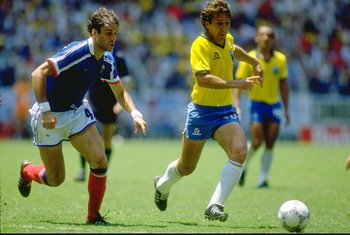 21 Jun 1986:  Zico (right) of Brazil takes on Batiston of France during the World Cup quarter-final at the Jalisco Stadium in Guadalajara, Mexico. France won 4-3 on penalties. \ Mandatory Credit: David  Cannon/Allsport