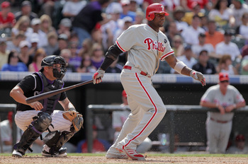 DENVER, CO - AUGUST 03:  Ryan Howard #6 of the Philadelphia Phillies takes an at bat as catcher Eliezer Alfonzo #55 of the Colorado Rockies backs up the plate at Coors Field on August 3, 2011 in Denver, Colorado. The Phillies defeated the Rockies 8-6.  (P