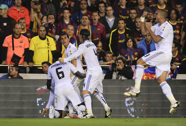 VALENCIA, SPAIN - APRIL 20:  Cristiano Ronaldo of Real Madrid (L) celebrates with his teammates after scoring his first team's goal during the Copa del Rey Final between Real Madrid and Barcelona at Estadio Mestalla on April 20, 2011 in Valencia, Spain.