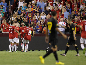 LANDOVER, MD - JULY 30: Members of Manchester United celebrate their second half goal against Barcelona during a friendly match at FedExField on July 30, 2011 in Landover, Maryland.  Manchester United won 2-1.  (Photo by Rob Carr/Getty Images)