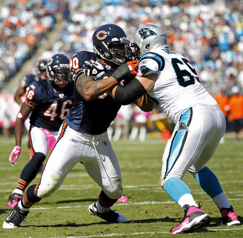 CHARLOTTE, NC - OCTOBER 10: Offensive tackle Jordan Gross #69 of the Carolina Panthers blocks defensive end Julius Peppers #90 of the Chicago Bears at Bank of America Stadium on October 10, 2010 in Charlotte, North Carolina. (Photo by Geoff Burke/Getty Im