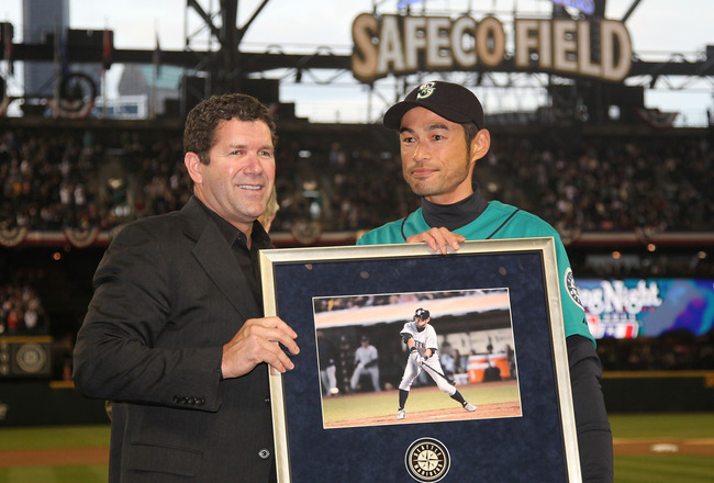 SEATTLE - APRIL 08:  Right fielder Ichiro Suzuki #51 (R) of the Seattle Mariners is presented with an award by Edgar Martinez for becoming the Mariners' all-time hits leader prior to the Mariners' home opener against the Cleveland Indians at Safeco Field