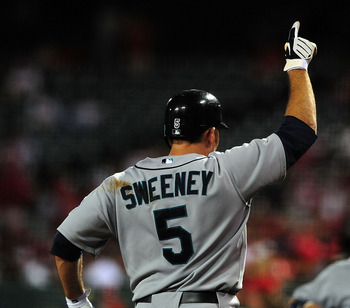 ANAHEIM, CA - SEPTEMBER 08: Mike Sweeney #5 of the Seattle Mariners celebrates a home run with teammates against the Los Angeles Angels of Aneheim on September 8, 2009 at Angel Stadium in Anaheim, California.  (Photo by Jacob de Golish/Getty Images)