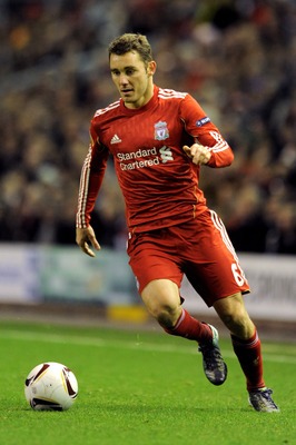 LIVERPOOL, ENGLAND - DECEMBER 15:  Fabio Aurelio of Liverpool runs with the ball during the UEFA Europa League Group K match between Liverpool and FC Utrecht at Anfield on December 15, 2010 in Liverpool, England.  (Photo by Clint Hughes/Getty Images)