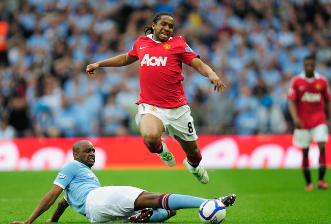 LONDON, ENGLAND - APRIL 16:  Patrick Vieira of Manchester City tackles Anderson of Manchester United during the FA Cup sponsored by E.ON semi final match between Manchester City and Manchester United at Wembley Stadium on April 16, 2011 in London, England