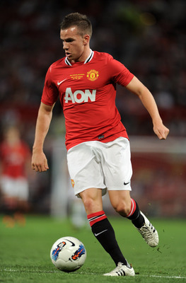 MANCHESTER, ENGLAND - AUGUST 05:  Tom Cleverley of Manchester United in action during Paul Scholes' Testimonial Match between Manchester United and New York Cosmos at Old Trafford on August 5, 2011 in Manchester, England.  (Photo by Chris Brunskill/Getty