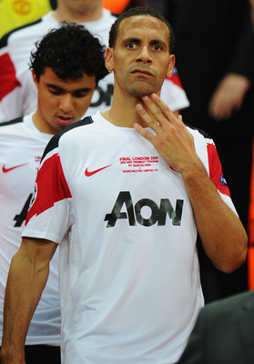 LONDON, ENGLAND - MAY 28:  Rio Ferdinand of Manchester United looks dejected after defeat in the UEFA Champions League final between FC Barcelona and Manchester United FC at Wembley Stadium on May 28, 2011 in London, England.  (Photo by Clive Mason/Getty