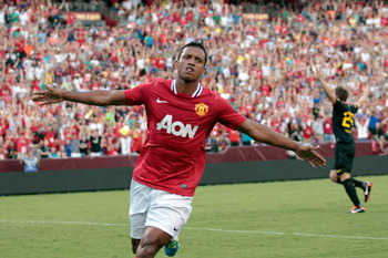 LANDOVER, MD - JULY 30: Nani #17 of  Manchester United celebrates scoring a first half goal against Barcelona during a friendly match at FedExField on July 30, 2011 in Landover, Maryland.  (Photo by Rob Carr/Getty Images)