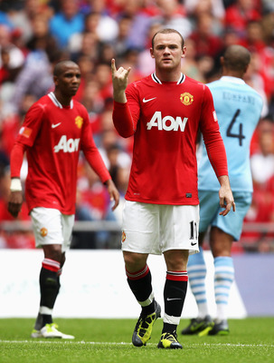 LONDON, ENGLAND - AUGUST 07:  Wayne Rooney of Manchester United gestures during the FA Community Shield match sponsored by McDonald's between Manchester City and Manchester United at Wembley Stadium on August 7, 2011 in London, England.  (Photo by Ian Wal