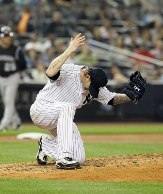 NEW YORK, NY - JUNE 24:  A.J. Burnett #34 of the New York Yankees reacts after Chris Nelson (not pictured) of the Colorado Rockies was called safe on a sixth inning stolen base on June 24, 2011 at Yankee Stadium in the Bronx borough of New York City.  (Ph
