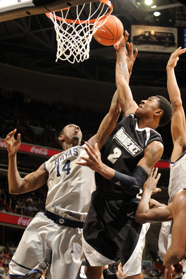 WASHINGTON, DC - FEBRUARY 5:  Marshon Brooks #2 of the Providence Friars takes a shot over Henry Sims #14 of the Georgtown Hoyas during a college basketball game on February 5, 2011 at the Verizon Center in Washington, DC.  The Hoyas won 83-81.  (Photo by