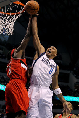 DALLAS, TX - APRIL 16:  Forward Shawn Marion #0 of the Dallas Mavericks is fouled by Gerald Wallace #3 of the Portland Trail Blazers in Game One of the Western Conference Quarterfinals during the 2011 NBA Playoffs on April 16, 2011 at American Airlines Ce
