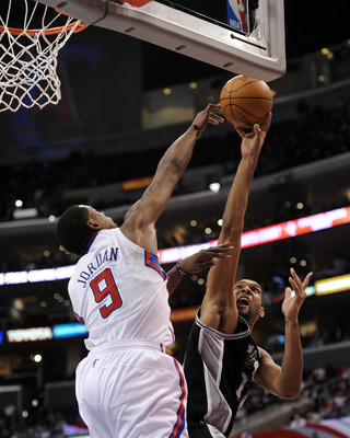 LOS ANGELES, CA - DECEMBER 01:  Tim Duncan #21 of the San Antonio Spurs has his shot blocked by DeAndre Jordan #9 of the Los Angeles Clippers during a 90-85 Clipper victory at the Staples Center on December 1, 2010 in Los Angeles, California.  NOTE TO USE