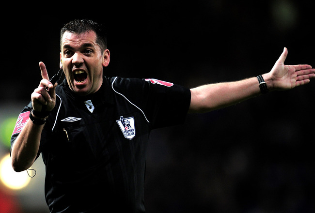 LONDON, ENGLAND - MARCH 23:  Phil Dowd, the match referee, gestures during the Barclays Premier League match between West Ham United and Wolverhampton Wanderers at the Boleyn Ground on March 23, 2010 in London, England.  (Photo by Shaun Botterill/Getty Im
