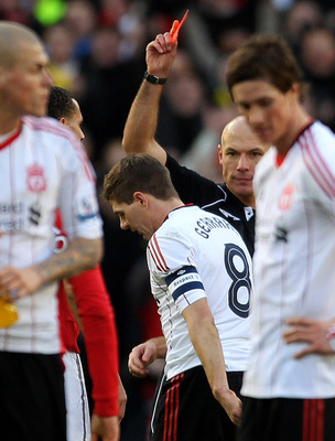 MANCHESTER, ENGLAND - JANUARY 09:  Referee Howard Webb shows Steven Gerrard of Liverpool a red card following his challenge on Michael Carrick of Manchester United during the FA Cup sponsored by E.ON 3rd round match between Manchester United and Liverpool