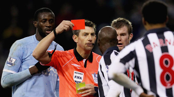 WEST BROMWICH, ENGLAND - NOVEMBER 07: Referee Lee Probert shows Youssouf Mulumbu of West Bromwich Albion a red card during the Barclays Premier League match between West Bromwich Albion and Manchester City at The Hawthorns on November 7, 2010 in West Brom