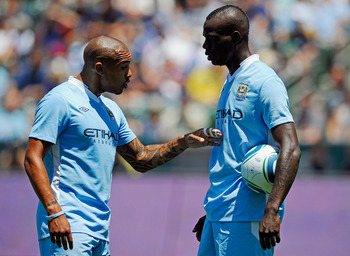 CARSON, CA - JULY 24:  Nigel de Jong #34 of Manchester City speaks with teammate Mario Balotelli #45 before he scored on a penalty kick against Los Angeles Galaxy during the Herbalife World Football Challenge 2011 at the Home Depot Center on July 24, 2011
