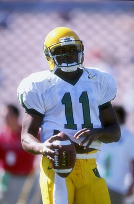 17 Oct 1998:Akili Smith #11 of the Oregon Ducks looks to pass during the game against UCLA at the Rose Bowl in Pasadena, California. UCLA defeated Oregon 41-38. Mandatory Credit: Todd Warshaw  /Allsport