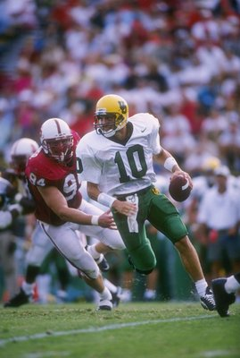 12 Oct 1996:  Quarterback Tony Graziani of the Oregon Ducks rushes rolls out of the pocket during the Ducks 27-24 loss to the Stanford Cardinal at Stanford Stadium in Stanford, California. Mandatory Credit: Otto Greule Jr.  /Allsport